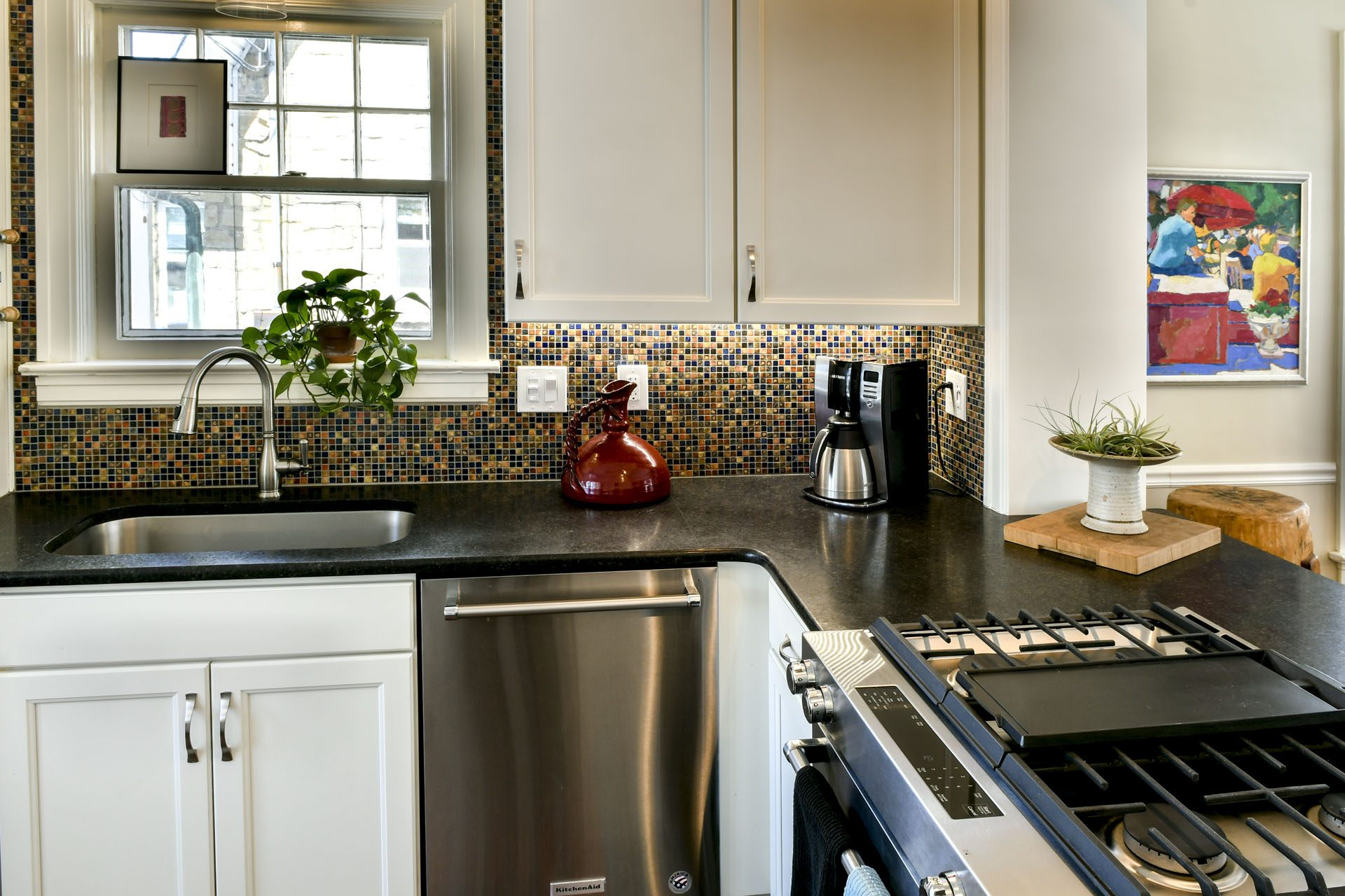 Louisville Interior Designer, Louisville Renovation Designer, Kitchen Renovation, Multi-Colored Backsplash, Stainless Appliances, Colorful Art, Hardwood Flooring, White Kitchen Cabinets, Granite Countertops, Stainless Fixtures, Beautiful Kitchen Renovation