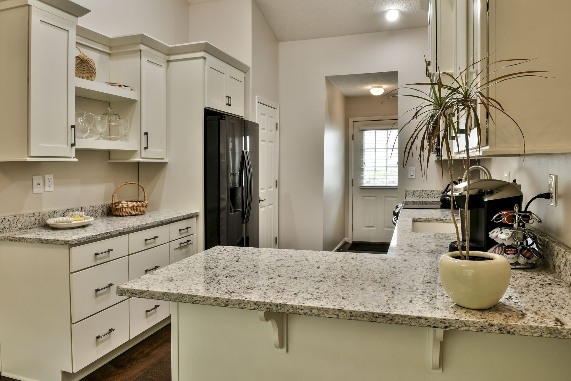 Louisville Interior Designer, Louisville Renovation Designer, Whole Home Renovation, White Kitchen Cabinets, Hardwood Flooring, Black Appliances, Light and Air, Kitchen Lighting, Granite Countertops, Bath Renovation