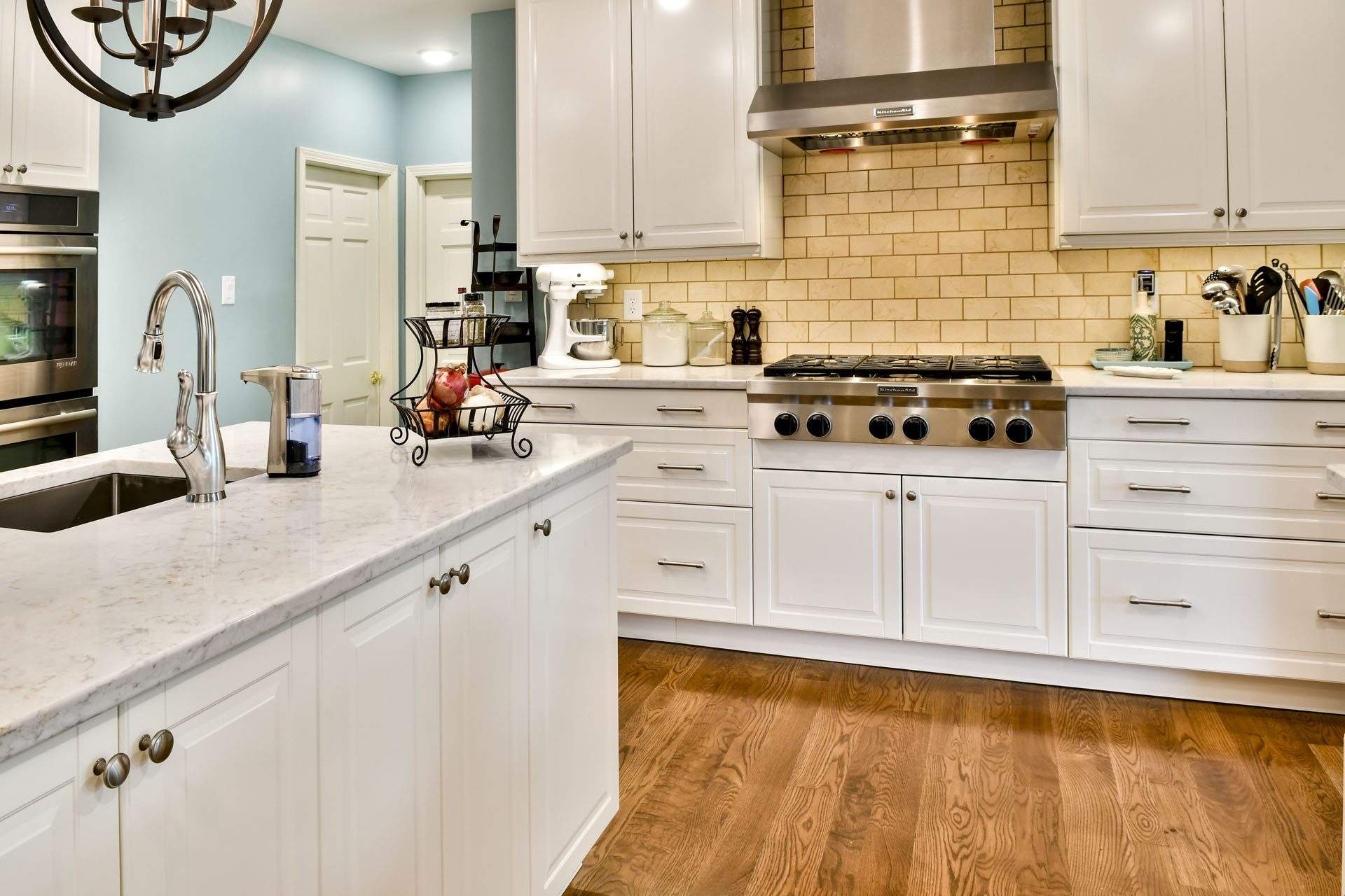 Louisville Interior Designer, Louisville Renovation Designer, Kitchen Renovation, Kitchen Design, White Kitchen Cabinets, Granite Countertops, Subway Tile Backsplash, Stainless Appliances, Kitchen Island, Glass Kitchen Cabinet Doors, Hardwood Floors, Stainless Apron Front Sink, Kitchen Lighting