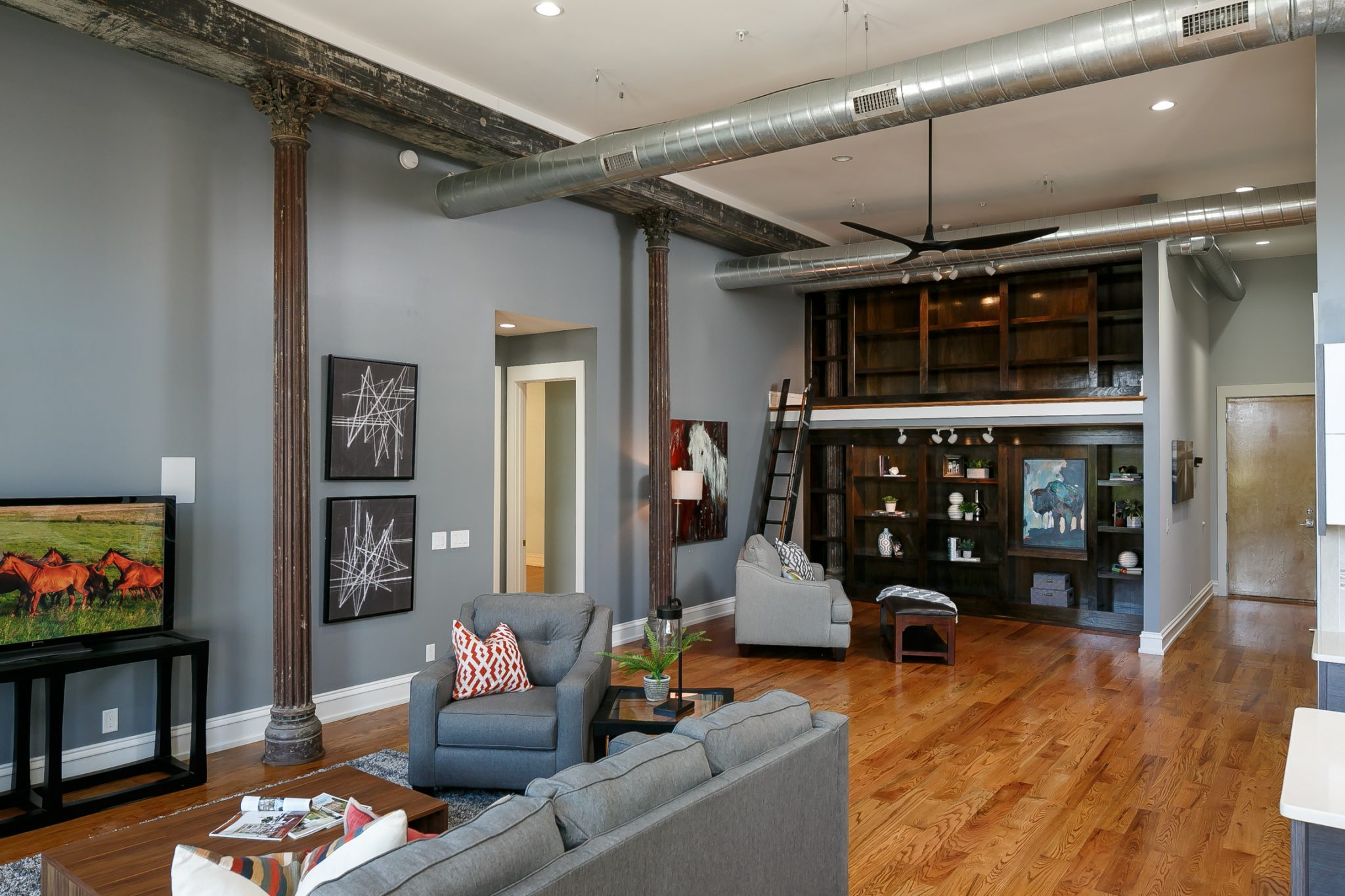 Louisville Interior Designer, Louisville Renovation Designer, Louisville Home Staging, Urban Loft, Industrial Loft, Exposed Brick, Hardwood Flooring, Modern Decor, Views of Downtown, Falls City Condo, Cool Color Scheme, Staging Sells