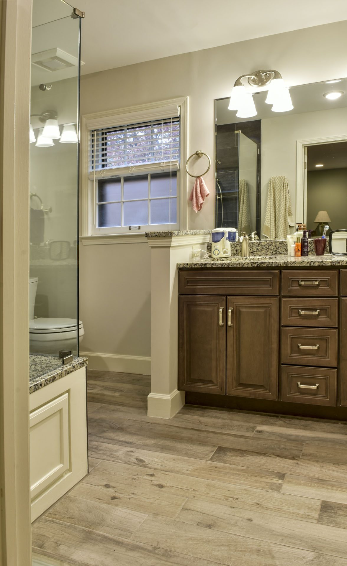 Louisville Kentucky Master Bath Renovation, Luxury Vinyl Tile, Glassed-in Shower, Charcoal Tile, Shower Bench, Multiple Shower Heads, Waterfall Basket Weave Shower Tile, Double Sink, Granite Vanity Top, Brushed Nickel Finishes