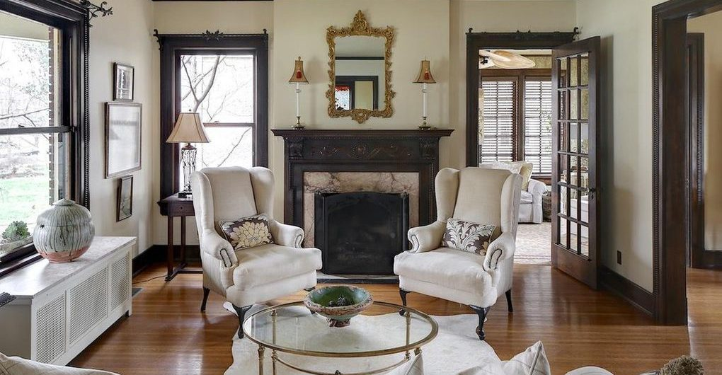 Louisville Home Staging, Louisville Interior Design, Louisville Renovation Design, artwork, hardwood flooring, accessories, fireplace, wing chairs, mirrors