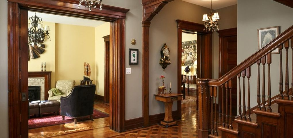 Louisville Home Staging, Louisville Interior Design, Louisville Renovation Design, Hardwood flooring, foyer, grand staircase, accessories, foyer mirror, foyer fireplace, historic home, stained glass