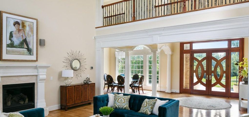Louisville Home Staging, Louisville Interior Design, Louisville Renovation Design, artwork, hardwood flooring, accessories, fireplace, wing chairs, catwalk, great room, dining room, custom front door, foyer