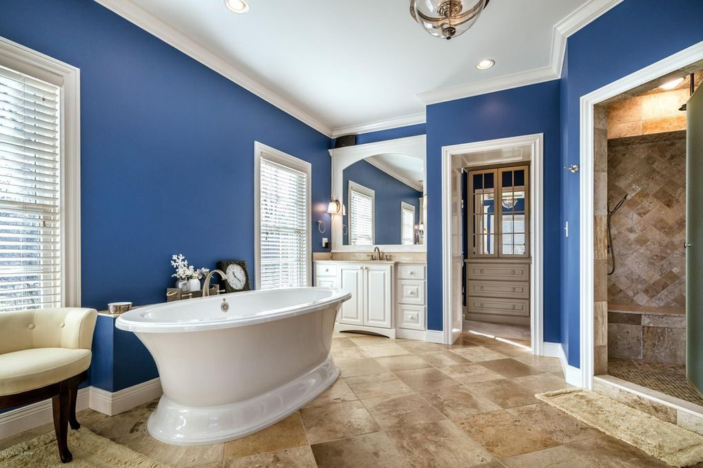 Louisville Interior Design, Louisville Home Staging, vanity lighting, soaking tub, master bathroom, ceramic tile flooring, blue bathroom, custom tile step in shower, white vanity