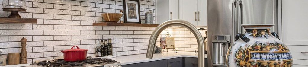 Louisville Home Staging, Louisville Interior Design, Louisville Renovation Design, Louisville Kitchen Design, White Kitchen Cabinetry, Stainless vent hood, artwork, accessories, kitchen island, granite countertops, stainless appliances, gas range, white subway tile, butcher block counter top, floating shelves