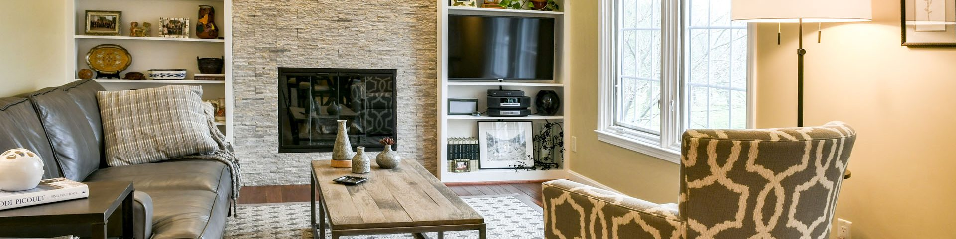 Louisville Home Staging, Louisville Interior Design, Louisville Renovation Design, Fireplace, stacked stone fireplace, built-in shelving, area rug, accessories, lighting, hardwood flooring