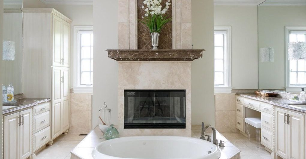 Louisville Interior Design, Louisville Home Staging, vanity lighting, soaking tub, master bathroom design, ceramic tile flooring, white vanity, bathroom renovation, bathroom fireplace