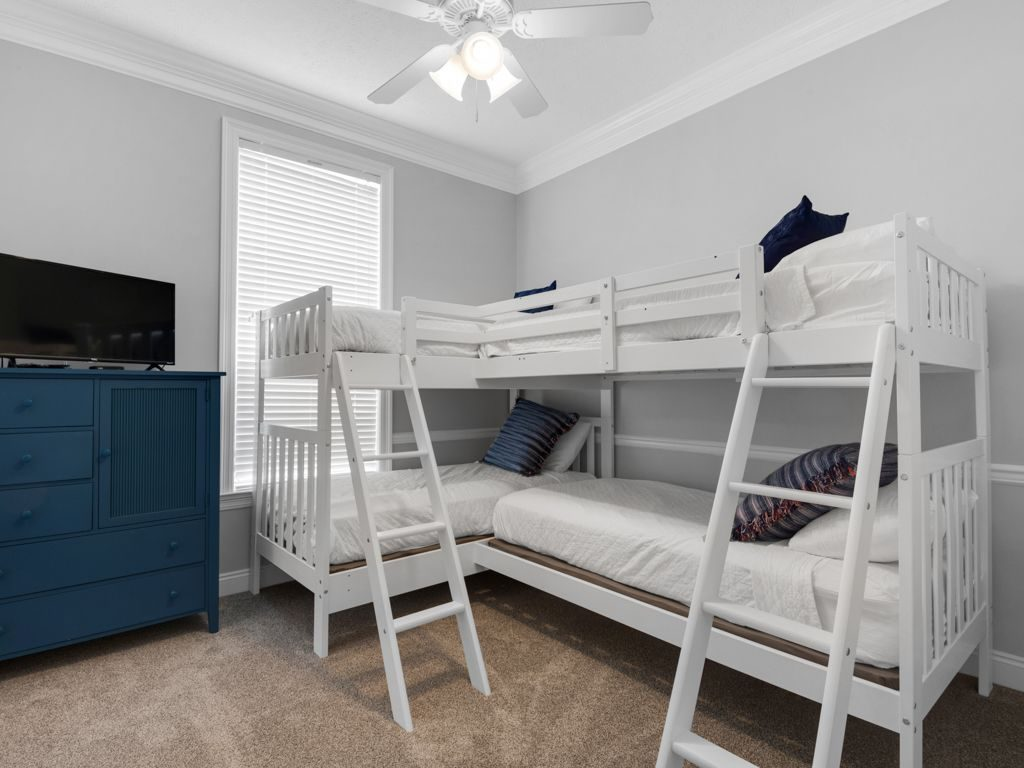 Vacation Getaway, Winter Getaway, Louisville interior designer, vacation home, beach retreat, kids' room, bunk beds, sleeps four, tan carpet, media center