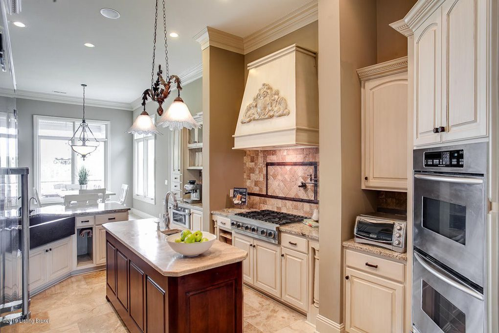 Louisville Home Staging, Louisville Interior Design, Louisville Renovation Design, Louisville Kitchen Design, White Kitchen Cabinetry, artwork, accessories, kitchen island, kitchen island lighting, granite countertops, stainless appliances, gas range