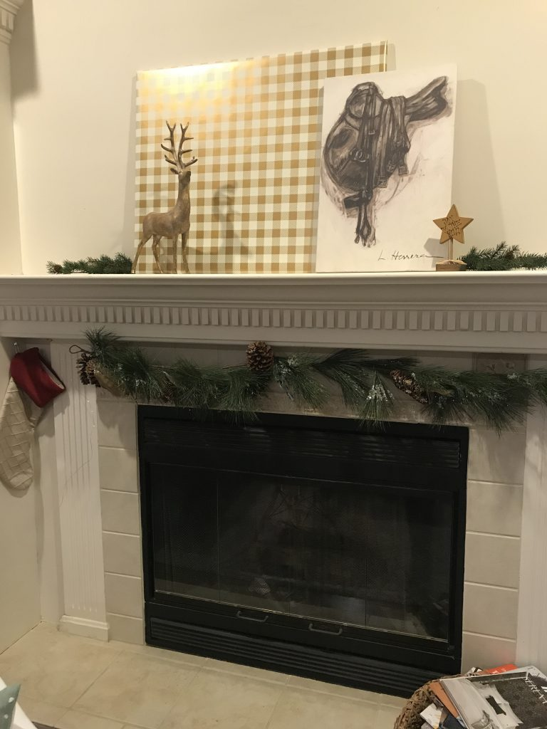 Louisville holiday decor, gold reindeer, stockings, fireplace, garland, star