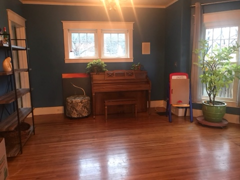 empty family room, hardwood floors, windows, blue wall paint